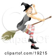 Sexy Blond Witch In A Tight Black Dress Stockings Hat And Black Shoes Flying Through The Sky On A Broom