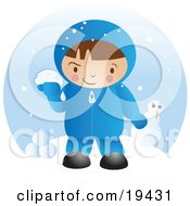 Little Boy In Winter Clothing Up To Mischief And Preparing To Throw Snowballs After Making A Snowman On A Winter Day