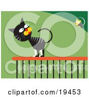 Clipart Illustration Of A Frisky Black And Gray Cat On A Porch Railing Looking At A Mouse On A Bush