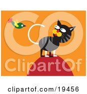Clipart Illustration Of A Hunting Cat On Top Of A Hill Watching A Green Bird Flying Around