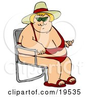 Pleasantly Plump Blond White Lady In A Red Bikini Hat And Sandals Seated In A Beach Chair And Enjoying Summer Weather