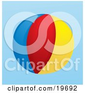 Colorful Beach Ball Over A White Background