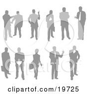 Clipart Illustration Of A Collection Of Businessmen And Businesswomen Silhouetted In Poses by AtStockIllustration