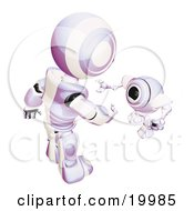 Short Purple And White Spybot Webcam Looking Up And Talking With A Humanoid Robot On A White Background