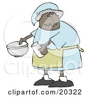 Black Lady In A Green Apron Putting Ingredients In A Mixing Bowl While Baking In A Kitchen