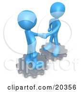 Clipart Illustration Of Two Blue People Standing On Silver Cog Gears Shaking Hands Upon Agreement Of A Business Deal