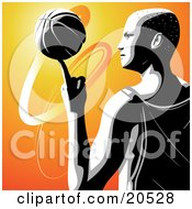 Talented Pro Basketball Player In Profile Spinning The Ball On The Tip Of His Pointer Finger