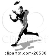 Athletic American Football Player Catching A Ball During A Game
