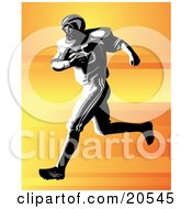 Strong Football Player Holding The Ball To His Chest While Running During A Game