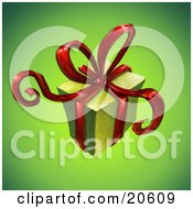 Christmas Present Gift Wrapped In Green Paper With Red Ribbons And A Bow