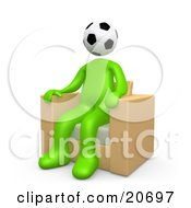 Green Man With A Soccer Ball Head Seated In A Chair