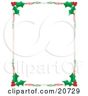 Christmas Stationery Border Of Red Berries And Green Holly Leaves Over A White Background