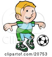 Clipart Illustration Of A Happy Blond Boy Ion A Blue And Green Uniform Kicking A Soccer Ball During A Game
