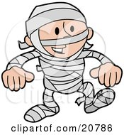Laughing Boy In A Mummy Costume Covered In Gauze