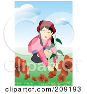 Girl Planting Red Flowers In A Garden
