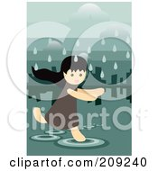 Girl Running Through A Puddle On A Rainy Day