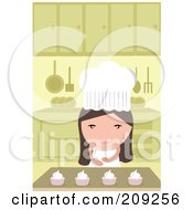 Little Chef Girl Making Cupcakes In A Kitchen