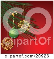 Clipart Illustration Of A Christmas Tree Branch Decorated In Golden Snoflake And A Green Bauble Ornaments by elaineitalia