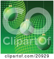 Three Differently Patterned Christmas Baubles Suspended Over A Background Of Green Ornaments by elaineitalia