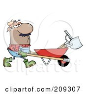 Hispanic Male Landscaper Pushing A Rake And Shovel In A Wheelbarrow