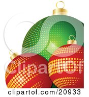 Two Red Glass Christmas Ornaments With Gold Dots In Front Of A Green Bauble With Yellow Dots by elaineitalia
