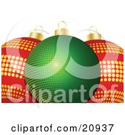 Glass Christmas Baubles One Green With Yellow Dots Two Red With Golden Dots Over A White Background by elaineitalia