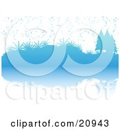 Blue Wintry Christmas Scene Of Snow Falling On Evergreen Trees And Plants Reflecting In Water