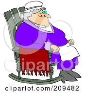 Relaxed Old Woman Sitting In A Rocking Chair
