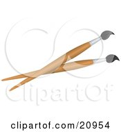 Clipart Picture Of A Two Wooden Handled Paintbrushes On A White Background