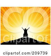 Royalty Free RF Clipart Illustration Of A Silhouetted Handicap Man In A Wheelchair Holding His Arms Up Atop A Mountain At Sunset by KJ Pargeter