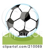 Royalty Free RF Clipart Illustration Of A Soccer Ball With A Blue Outline On A Grassy Hill
