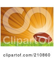 Royalty Free RF Clipart Illustration Of A Football Resting On Grass Against A Bursting Orange Background by elaineitalia