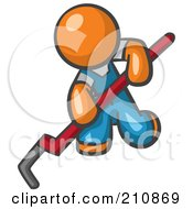 Orange Man Design Mascot Kneeling And Using A Pipe Wrench