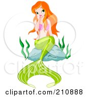 Flirty Red Haired Mermaid Sitting On A Rock