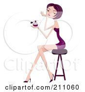 Pretty Woman In A Purple Dress Sitting On A Stool And Spritzing Perfume