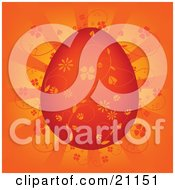 Clipart Illustration Of A Beautiful Intricate Red Easter Egg With Orange Floral Designs Over A Lighted Background