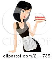 Pretty Black Haired Woman In An Apron Holding A Cake In Hand