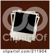 Royalty Free RF Clipart Illustration Of A Pile Of Blank Pictures On A Wooden Surface by KJ Pargeter