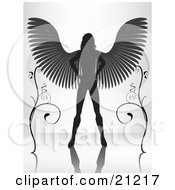 Clipart Illustration Of A Silhouetted Female Angel Standing With Her Wings Spanned Between Two Vines On A Reflective Surface by elaineitalia