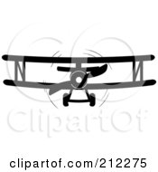 Royalty Free RF Clipart Illustration Of A Black And White Biplane In Flight by Pams Clipart #COLLC212275-0007