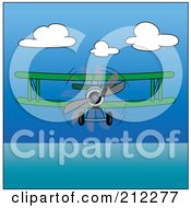 Royalty Free RF Clipart Illustration Of A Green Biplane In Flight Over The Ocean