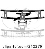 Royalty Free RF Clipart Illustration Of A Black And White Biplane And Reflection In Flight