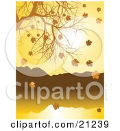 Nature Background Of Golden Autumn Leave Falling Off Of A Nearly Bare Tree Over A Lake by elaineitalia