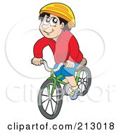 Happy Boy Riding His Bicycle And Wearing A Helmet