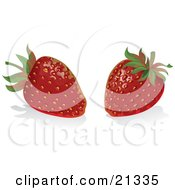 Two Ripe Red Strawberries Resting On A White Reflective Counter