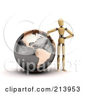 3d Wooden Mannequin Leaning Against A Globe Of North And South America