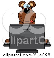 Royalty Free RF Clipart Illustration Of A Big Bear Smiling And Using A Computer by Cory Thoman