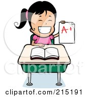Black Haired School Girl Holding Up An A Plus Report Card And Sitting At Her Desk