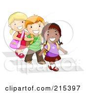 Diverse School Kids Walking In Line On A Crosswalk