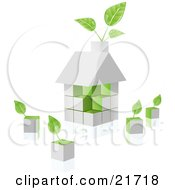 White Home Built Of Blocks With Green Sides And Plants Sprouting From The Chimney And Loose Cubes